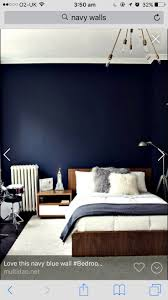 Paint a really dark navy wall and combine with light bright bed linen.  Michelle James' Brooklyn Brownstone, Photography by Novembrino Novembrino  Novembrino ...