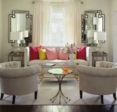 window chair furniture. the symmetry of mirrors and tables on either side couch make window stand out more than it would if nothing were standing in its way. chair furniture
