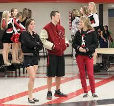 from left violet weibel aron kloorgan sanger wear their letter jackets while partiting in a being ed at central high school