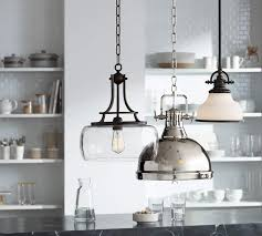 three lamps plus pendants in a kitchen setting