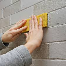 sponging paint on a brick face