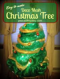 how to make a deco mesh tree using a tomato cage and embellishments tutorial