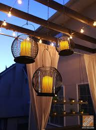 deck decorating ideas a pergola with string lights and hanging lanterns