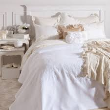 white bedding victorian bed with a touch of ivory