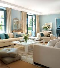 interesting blue living room decor white and brown large rug beige sofas blue cushions white wooden