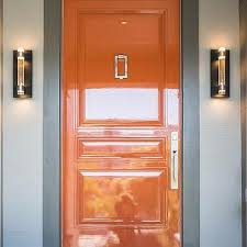Remodel Glossy Hermes Orange Door With Gray Trim Moldings Decorpad Glossy Orange Lacquered Front Door Design Ideas