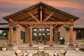 attached covered patio ideas. Even The Rear Of This Home Includes A Grand Architectural Statement. Tall  Wooden Beams Lead Attached Covered Patio Ideas I