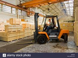 Warehouse Man Driving Forklift Truck Uk Stock Photo 19868473 Alamy