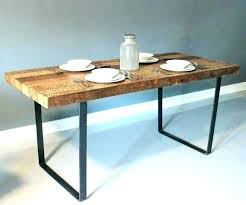 dining table with metal legs industrial dining table reclaimed pinewood and metal frame available round dining dining table with metal legs wood