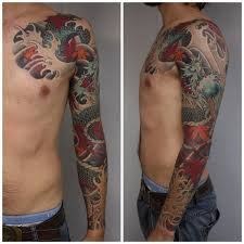 татуировки черный дракон в стиле ориентал грудь плечо предплечье