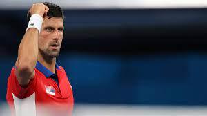 Novak Djokovic brushes Jan-Lennard ...