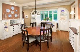 dining room white cabinets. Traditional Dining Room White Recessed Corner Cabinets In Asymmetric Shape Dark Toned Wood Floors Round Top T