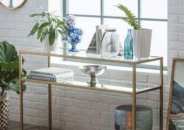styled gold frame console table with glass shelves