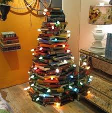 ... this DIY alternative Christmas tree is a great way to use what you  already have. Stack the books in circles and wrap a string of lights around  it and ...