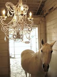 dreamy white barn white horse and chandelier