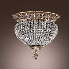 captivating flushmount features antique brass finish frame adorned by crystal beads