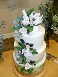 Sage Green And Gold Wedding Cake With Magnolias And Silver Dollar