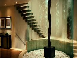 Interior Terrific Curve Concrete Staircase And Cool Glass Watter - Iron man house interior