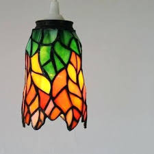 glass pendant lamp shades hanging pendant lamp featuring a vintage stained glass lamp shade orange green