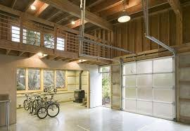 polished concrete floors frosted glass retractable doors industrial pendant lamps woodburning stove stainless utility sink and bicycle storage
