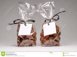 two elegant gifts of chocolate truffles with white label