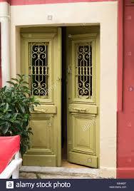 ornamental doors ajar fiscardo kefalonia in greece stock image