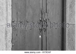 double white door texture. Distressed Wooden Double Doors With A Stone Frame, Architectural Details, And Two Elegant Handles White Door Texture