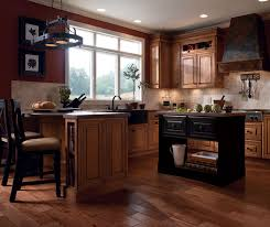 coffee colored kitchen cabinets by kemper cabinetry