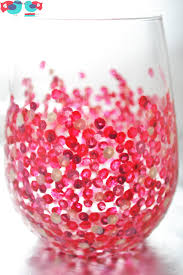 hand painted stemless wine gl with red dots using enamel paint and baking in the oven