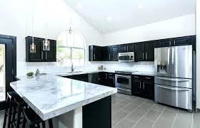 small kitchen with peninsula kitchen peninsula with seating transitional kitchen with dark cabinets dining peninsula and