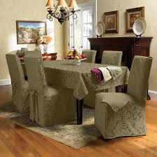 cozy dining room chair covers and parson chair covers and rectangular dining table with tablecloth and beige rugs on laminate wood flooring plus black
