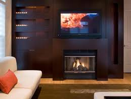 tv above wood fireplace
