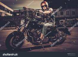 tattooed biker his bobber style motorcycle stock photo 269416154