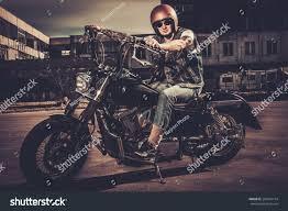 tattooed biker his bobber style motorcycle stock photo 269416154