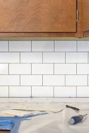 DIY White Subway Tile Backsplash | dreamgreendiy.com + @builddirect