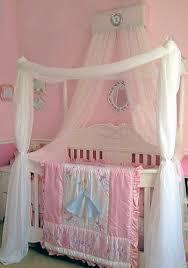 DIY crib canopy in a baby girl Disney theme nursery