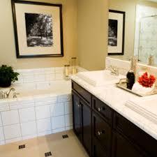 small bathroom remodel ideas on a budget. Bathroom Remodel Ideas On A Budget Black Frame Rectangular Mirror White Wall Mosaic Ceramic Tiles Bathtub Deck Free Standing Round Small