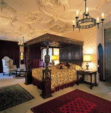 This Medieval Bedroom Has Been Decorated With A Canopy Bed And Gorgeous Sofa