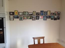 Unusual ways to hang pictures, picture display, picture frame display,  picture frame montage - Geometric Picture Frame Montage - Image 1