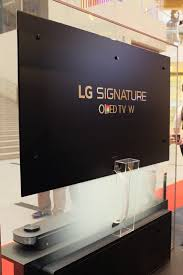 lg tv with soundbar. the oled w7 is mounted using four magnetic brackets, with a single ribbon cable connecting lg tv soundbar