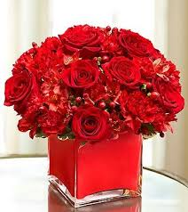 monochromatic red arrangement: bunch as many red flowers as can find  together for a spectacular