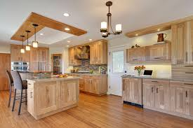 contemporary kitchen with quartz countertops and red birch cabinets kitchen with quartz countertops and light natural wood
