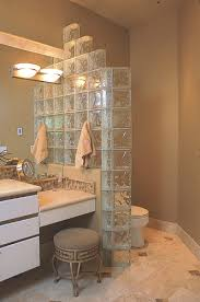 this stepped glass block panel is used as a privacy wall between the vanity and toilet