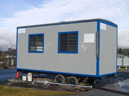 small portable office. A Small Portable Office On Wheels At Construction Site Warm Sunny Day.
