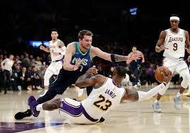 Luka gets 27, Mavs snap Lakers' 10-game win streak 114-100 ...