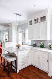 white shaker kitchen cabinets with granite countertops. Recycled Countertops White Shaker Kitchen Cabinets Lighting Flooring Sink Faucet Island Backsplash Subway Tile Granite Oak Wood Driftwood Glass Panel Door With I