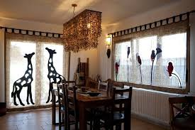 beautiful scenic window treatments and african sculptures and figurines highlight this space african inspired furniture