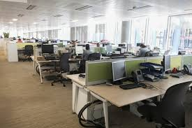 productive office space. The Operational Office Space Offers An Interior Expected From A Working Commercial Of Its Type With Rows Populated Desks And Computers Inhabiting Productive