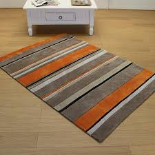 orange and grey striped rug
