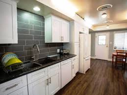 white kitchen cabinets with grey countertops quartz